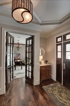 this makes me want to stain the french doors to our office. - love the dark doors with the white trim!