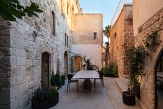 """Pitsou Kedem """"stitches"""" old and new inside Jaffa apartment Green Kitchen Interior, Porches, Table Verte, Old Jaffa, Pitsou Kedem, Fabric Room Dividers, Patio Central, Aluminum Screen, Steel Pergola"""