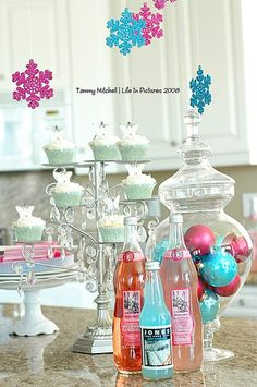 Cute idea to incorporate some sparkly snowflakes and sparkly Christmas bulbs in a vase for a winter shower. Could do silver, white, and blue for boy or silver, white and pink for a girl