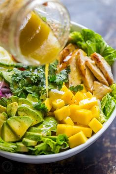 This Chicken Mango Avocado Salad recipe is loaded with juicy chicken, creamy avocado and that sweet pop of mango flavor takes this mango salad over the top. The sweet and tangy honey vinaigrette couldn't be easier! A Cheesecake Factory recipe (copycat). | natashaskitchen.com