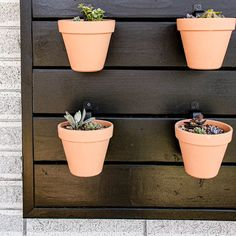 Are you looking to add a creative and unique piece to your garden? Read all about how to make this easy wood wall for a vertical pot garden! #creative #wood #idea #garden