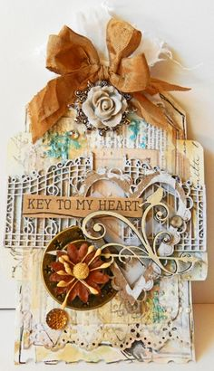 Tag created by DT member Erin Blegen using the Heart Set and Village Sign Post.
