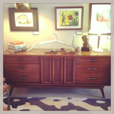 Mid century modern credenza. This piece would make a great entertainment consul. Now at vintage by design.
