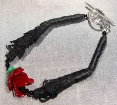 Black Lace Bracelet With a Sculpted Glass Red Rose. Made In The USA by Andreas Jewelry