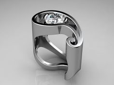 The Paisley Ring! - A very avante-garde modern design with a brilliant white diamond tension set inside an open curved platinum band!*