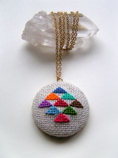 Golden Triangle Cross Stitch necklace from Etsy Cross Stitching, Cross Stitch Embroidery, Hand Embroidery, Cross Stitch Patterns, Mini Cross Stitch, Modern Cross Stitch, Diy Recycling, Embroidery Designs, Etsy Crafts