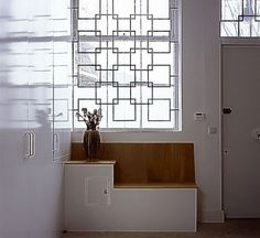 Lots of storage was built in the hallway; new security grilles on the windows lightened the look