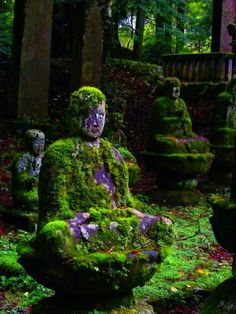..Love the fact that these statues are covered in moss. It makes them one with nature.