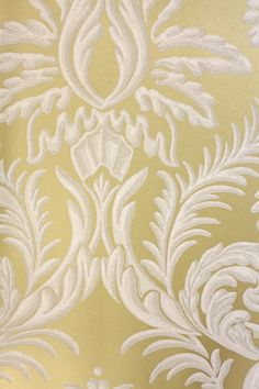 Ardwell Wallpaper A damask resembling plasterwork on a contrasting background, in gold and white.