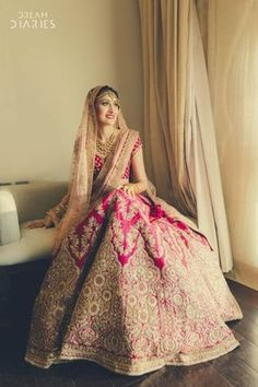 Looking for Beautiful Pink and gold bridal lehenga with light peach dupatta? Browse of latest bridal photos, lehenga & jewelry designs, decor ideas, etc. Indian Bridal Outfits, Indian Bridal Lehenga, Indian Bridal Fashion, Indian Bridal Wear, Red Lehenga, Indian Dresses, Lehenga Wedding Bridal, Eid Dresses, Wedding Mandap