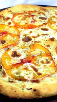 White Garlic Tomato Pizza - BRICK OVEN PIZZA AT HOME... How to turn your oven into a HIGH HEAT ITALIAN OVEN. This has the look and taste of a Fire Roasted Brick Oven Pizzeria!  There are a couple of tricks but just about any modern oven can reach HIGH TEMPERATURES for that unique taste and look.