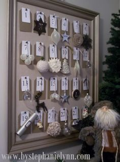 entry way - I place a tall slender tree along side so each night before bed we can countdown the days and move an ornament from the frame to the tree