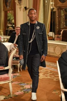 """PARIS, FRANCE - DECEMBER Pharell Williams walks the runway during """"Chanel Collection des Metiers d'Art : Paris Cosmopolite"""" show on December 2016 in Paris, France. (Photo by Pascal Le Segretain/Getty Images) Chanel Men, Chanel Fashion, Pharrell Williams, Chanel Street Style, Chanel Style, White Linen Suit, Long Winter Coats, Long Coats, Designer Suits For Men"""