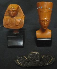Three  vintage Bakelite Egyptian revival inspired brooches.