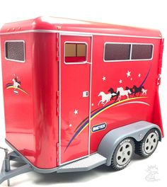 2611 Horse Trailer  Large 1:9 scale trailer for the traditional range of Breyer horses.  Aerodynamically designed tag-along trailer transports up to two large horses comfortably.  Features side door, back doors, tinted windows, rear horse chain...