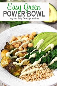 This Green Power Bowl is full of vegan goodness! A delicious budda bowl of whole grains, vegetables, & avocado with a cilantro lime sauce. It is healthy and a great way to have a quick dinner and tasty dinner on the table fast! vegan, vegetarian, vegan buddha bowl recipe, gluten-free #veganbuddhabowl #buddhbowl #powerbowl