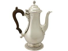 '1930's Coffee Pot' http://www.acsilver.co.uk/shop/pc/Sterling-Silver-Coffee-Pot-by-Richard-Comyns-George-III-Style-Antique-George-V-49p9119.htm