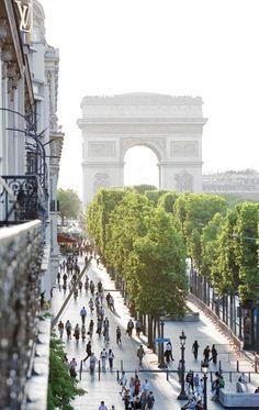 The grand Parisian avenue and the Arc de Triomphe in the background