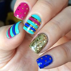 The perfect striped and polka dot party nails by @sensationails4u.
