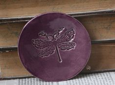 A personal favourite from my Etsy shop https://www.etsy.com/listing/111847121/purple-dragonfly-plate-ceramic-ring-dish