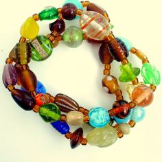 Three beautiful, glass beaded stretch bracelets in rustic, earthy brown, green and blue tones make up this trio, a perfect combination. Chunky, unique, and funky brightly colored glass beads neatly beaded onto a stretchy, durable elastic cord make up this set, about 7-7.5 inches around, and will stretch to fit most wrists. Organic and boho in style