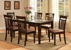 Rustic Wooden Dining Room Table On Rug Brown
