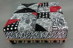 Statement Piece Upholstered Cocktail Ottoman Featuring a Pattern Blend of Plush Minky Fabrics in Black & White w/Red Accents and Lux Trim.