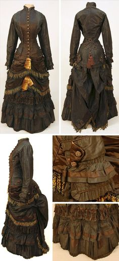 Black and brown silk bustle dress, 1880-82. Two-piece black taffeta. Tunic with brown satin pleated bib and swag bottom, ombreed ribbon and chenille fringe, carnival-beaded globe buttons, tiny pocket, scrolling cord & tassels on back, ruched & draped skirt with fringe & ribbons, ruffled & pleated front, cotton lining. Whitaker Auctions