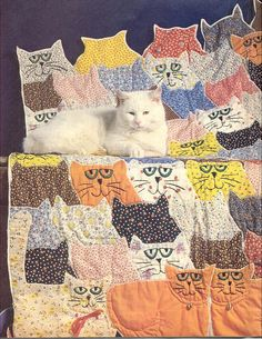 Calico Cats and Orange Toms Quilt by Woof Nanny, via Flickr