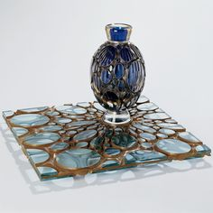 <i>Stiletto Fusion</i>, 2007; Blown glass with stiletto air trap inclusions and engraved lenses,industrial plate glass, copper, and silver; 12 x 18 x 18 inches