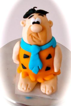 Fred Flinstone cake topper.