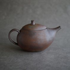 Slightly glazed red clay tea pot