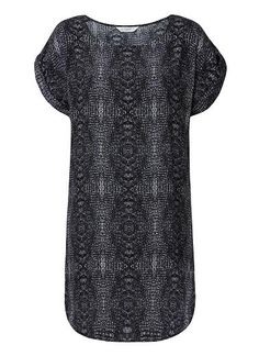 100% Viscose Crepe Snake Print Dress. Comfortable fitting silhouette features a scoop neck with short sleeves and dipped hem in an all over Snake print. Available in Multi as seen below.