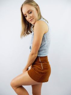 PRE-LOVED brown shorts. Brand / Unknown. Corduroy material. High waisted. 2 silver zipper closures at sides. Cotton/elastane. Marked size / 8. Recommended size / AU 8.