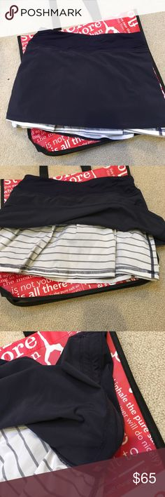 Lululemon Skirt/Skort Runch detail possible on sides. Navy blue with blue and white striped underskirt. Size 4. Great condition. lululemon athletica Skirts