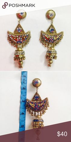 Gold party statement earrings Gorgeous party earrings in golden with silver , pink and blue  stones to add a different look . Jewelry Earrings