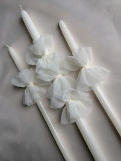 "ivory chiffon ruffles baptismal candle set includes one 21"" lambatha and two 17"" candles ​ the candles are used for the sacrament of baptism in the Eastern Orthodox churches, including Greek, Bulgarian, Serbian, Russian, Ukrainian, Antiochian and Romanian"