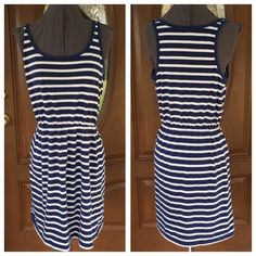 """OLD NAVY Striped Dress OLD NAVY Striped Dress.   Racerback.   Sleeveless.   Elastic gathered waist.  Navy blue & white striped cotton/polyester blend tee material.  Length 36"""" (shoulder to hem).   Great, used condition. Old Navy Dresses"""