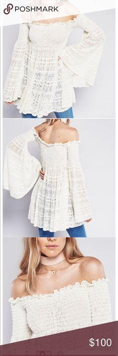 Free People Free Flow Peasant top new sz S dress Free flow peasant top NEw with out tags never worn . sz small . In an off-the-shoulder silhouette this sheer crochet tunic top features smocked elastic detailing on the bust and shoulders. Oversized flowy body and dramatic flared sleeves give this super cute style a vintage feel.  54% Cotton 44% Nylon 1% Rubber 1% Polyester Hand Wash Cold or Dry Clean Import Measurements for size Small Free People Tops Tunics