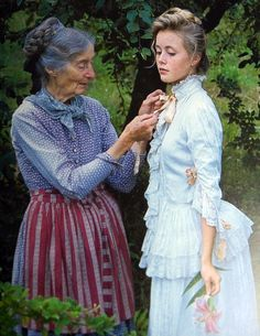Tasha Tudor adjusting a handmade dress