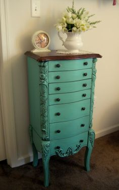 Turquoise Armoire -- Put it in the hallway to hold pens, papers and random things that don't have a place.