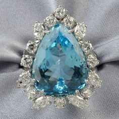 14kt White Gold, Aquamarine, and Diamond Ring, set with a pear-shaped aquamarine measuring approx. 17.50 x 13.35 x 8.10 mm, framed by marquise- and full-cut diamonds, approx. total diamond wt. 1.40 cts