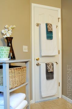 towel rods on the back of the door! Love this idea for small bathrooms! or our laundry room!