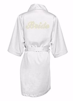 Celebrate your  big day with this must have custom satin robe with your name on the front in crystals .  These are perfect for a photo op of the bridal party and make a wonderful keepsake  too.  This satin robe  is luxurious and adorable.   It is embellished with rhinestone crystals on the back and front left chest.     These robes are high quality and embellished with silver and gold crystal rhinestones.  You  will be beaming in this robe.   Robe are kimono style with a   removable sash…