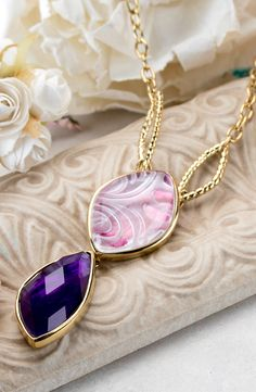 Quite remarkable quartz. This longer statement piece would be great with a white tee and some jeans. Make sure you check out the finished back!   Pink & Purple Quartz Doublet,Amethyst Bead 18k Gold Over Bronze Necklace
