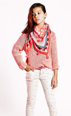 Tween fashion: sweater over patterned pants paired with a bright patterned scarf