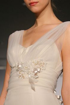 Wedding dress from the Christos Collection as shown at Fashion Week. Designs property of Christos and more can be seen online at www.getmarried.com/fashion/collections.php?designer=Christos