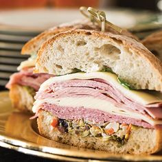 Muffaletta sandwiches are classic New Orleans street food.more great traditional Southern recipes and more by ordering your subscription of Cooking with Paula Deen  Sandwich Recipes, Lunch Recipes, Cooking Recipes, Muffaletta Recipe, Easy Party Food, Creole Recipes, Cuban Recipes, Picnic Foods, Wraps