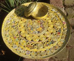 yellow flat bowl of recycled news paper