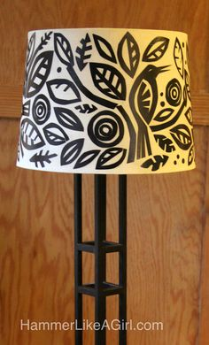 DIY lampshade is an easy-to-do decoupage project involving cut black paper and your favorite shapes.